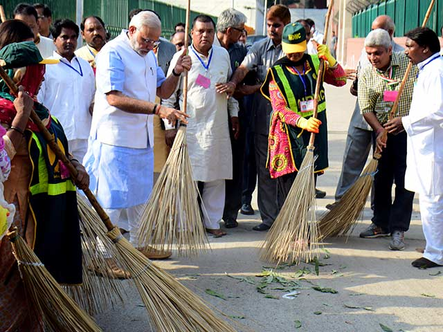Photo : The PM and a Broom. Clean India Mission Launched.