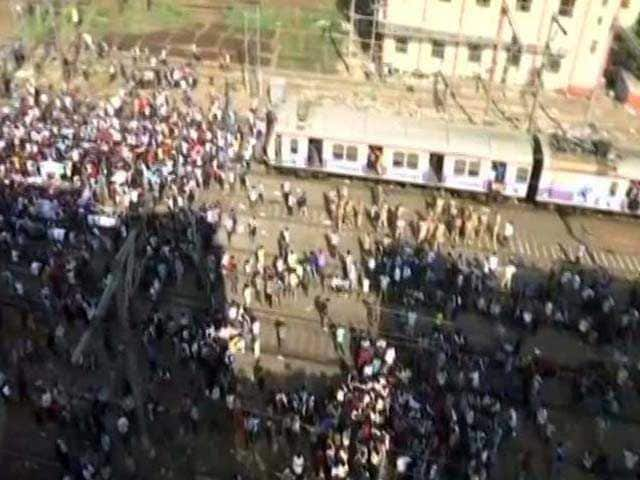 Photo : Mumbai Rail Roko: Train Services Hit As Students Demanding Railway Jobs Protest Sitting On Tracks