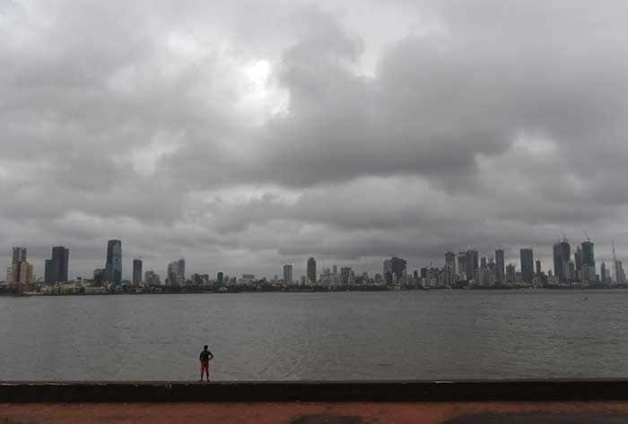 Pics: Monsoon Rains Arrive In Mumbai; People Hassled, But Happy