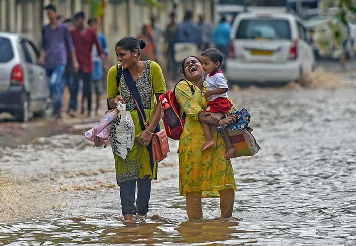 monsoon in mumbai Heavy monsoon rains have paralysed mumbai, india's financial hub, flooding streets and disrupting land, air and road traffic dozens of flights and local train services were cancelled on tuesday.