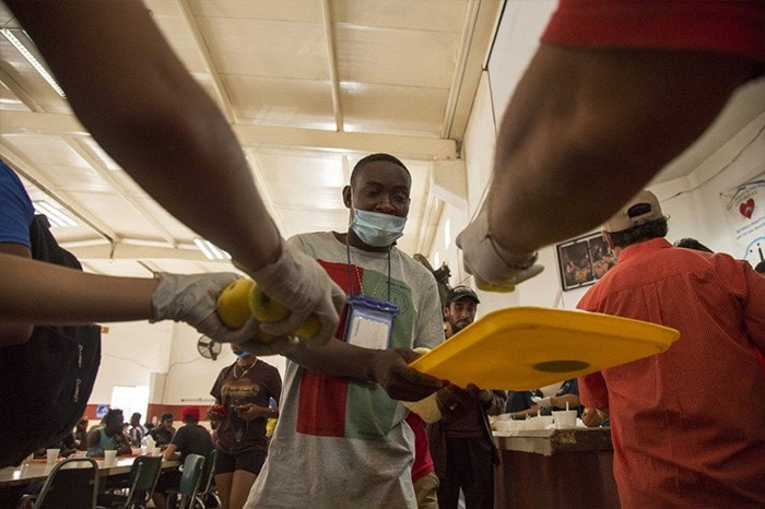 A Haitian migrant receives food at a shelter where he awaits for his immigration resolution in Monterrey, Mexico