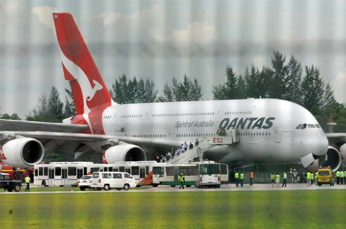 Qantas plane lands in Singapore after mid-air emergency