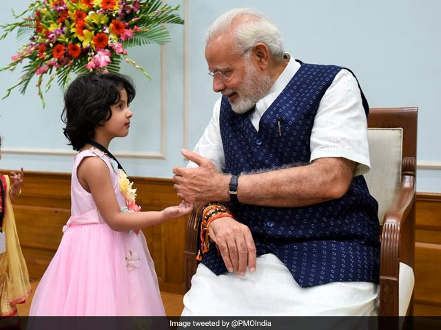 Photo : Pics: From Children To PM Modi, How Rakhi Strings Tied The Nation Today