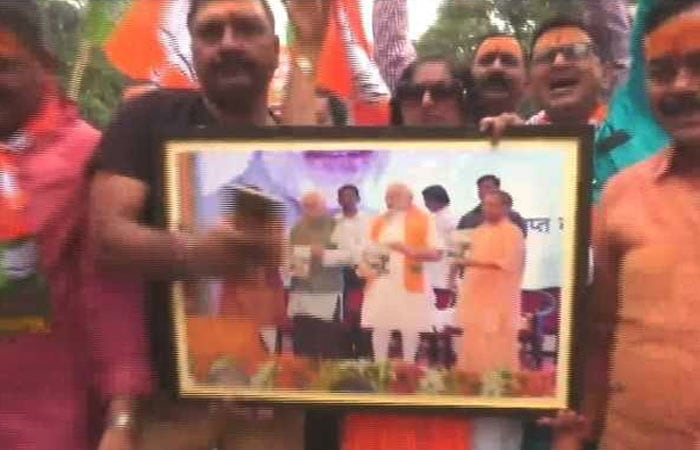 BJP Workers Celebrate In Varanasi As PM Modi Leads In Vote Count From His Seat