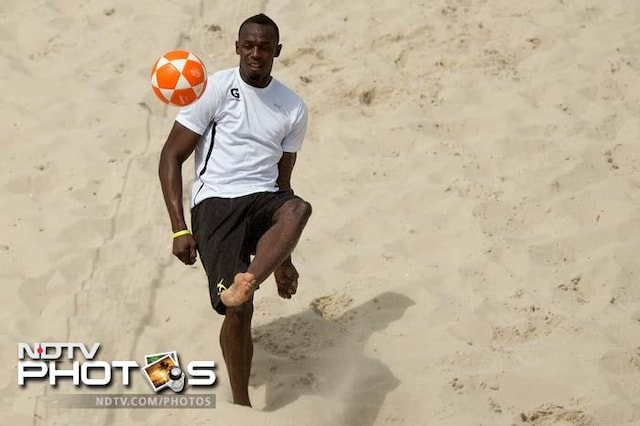 Bolting with sun, sand and a football