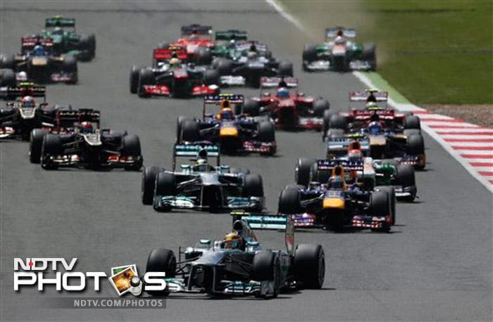 Nico Rosberg holds on to win thrilling British Grand Prix