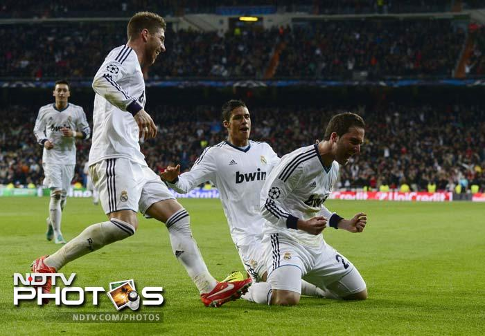 Madrid cruise, Dortmund held in Champions League quarters