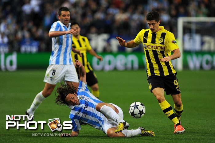 Madrid cruise, Dortmund held in Champions League quarters