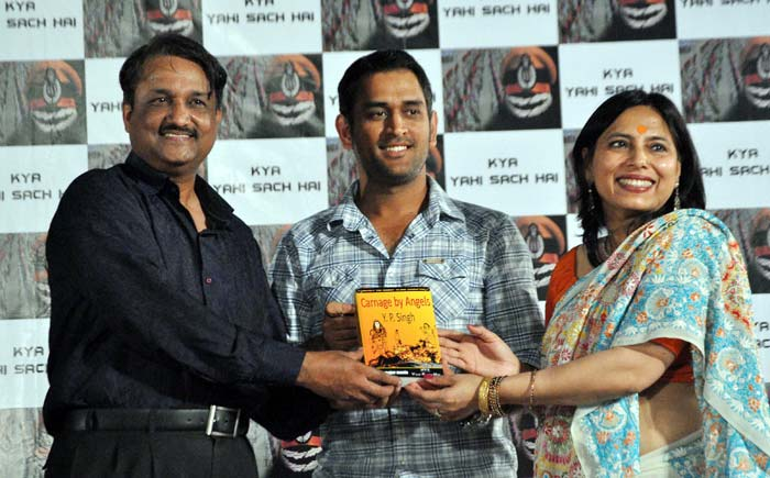 Dhoni at the music release of upcoming movie