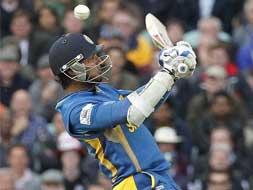 Photo : Sri Lanka keep semi-final hopes alive with 7-wicket win over England