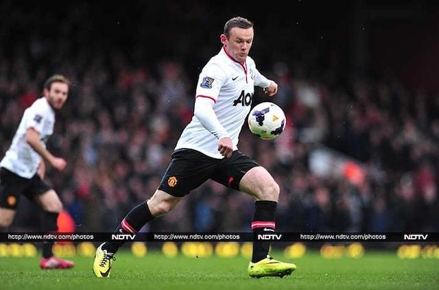 Rooney nets wonder goal, Suarez, Toure score hat-tricks