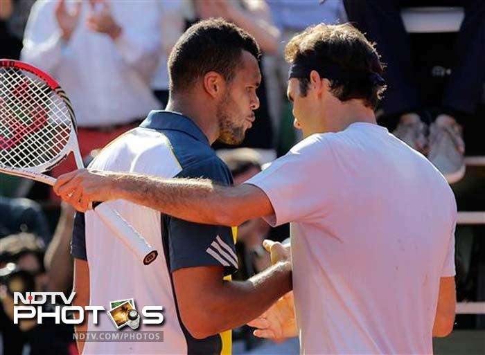 Roger Federer crashes out to home-favourite Jo-Wilfred Tsonga