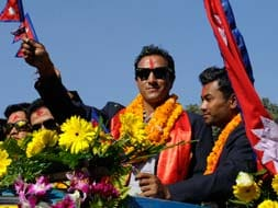 Photo : Nepal cricket team welcomed home in style