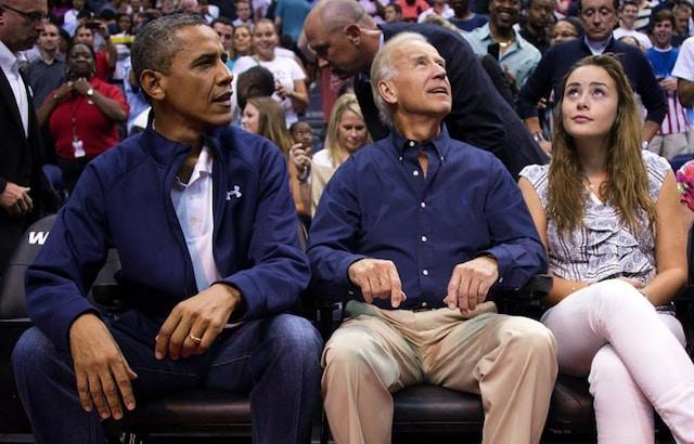 Obamas pose for Kiss Cam during a basketball match