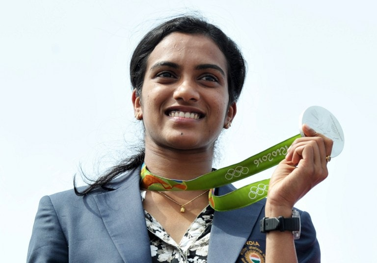 PV Sindhu, Coach Gopichand Receive Grand Welcome In Hyderabad