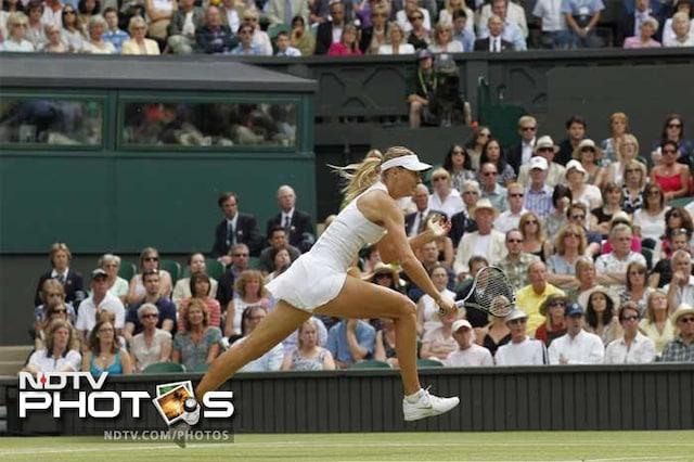 Kvitova stuns Sharapova to win Wimbledon