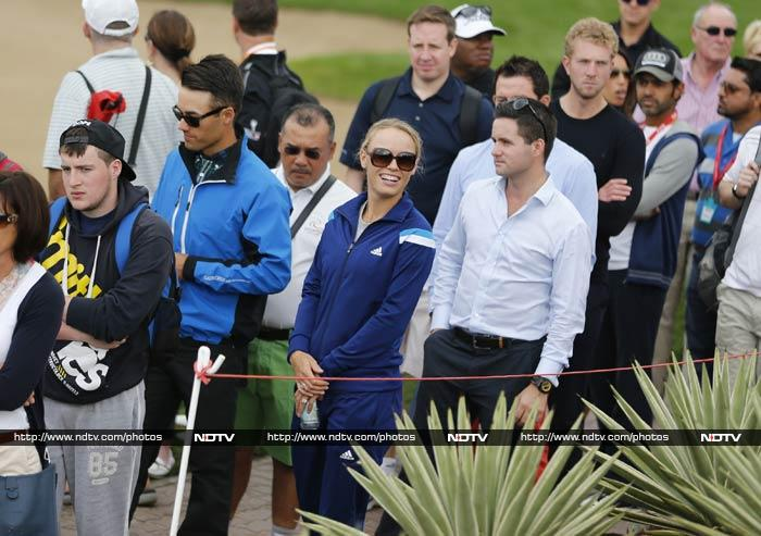 Out of Australian Open, Wozniacki joins Rory for golf