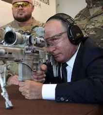 Vladimir Putin Shows Off Sniper Skills, Fires New Kalashnikov Rifle