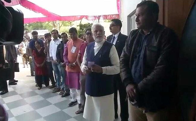 In Gujarat, PM Modi Waits In Voting Queue, Touches Brother's Feet After