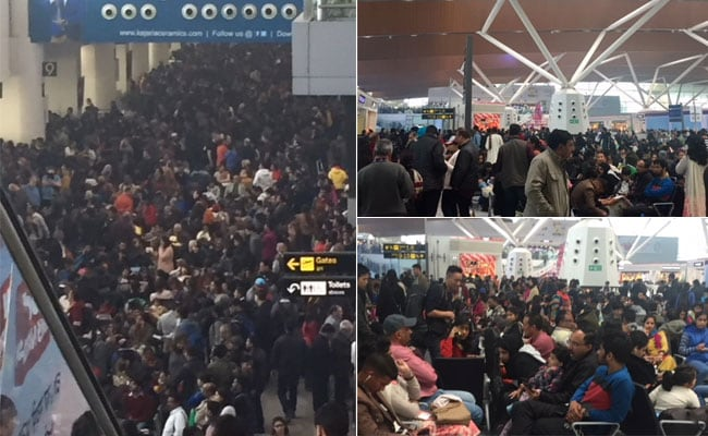 The Delhi airport terminals are packed with passengers who arrived early at the airport for their morning flights