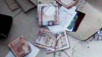 Video : Anna effect missing: Officials caught on camera trying to hide cash taken in bribes