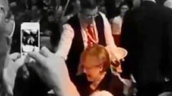 Video : Oops! Beer shower for German Chancellor Angela Merkel