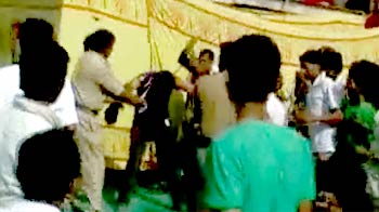 Video : Baba Ramdev's supporters beat up student for asking a question