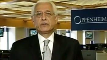 Video : China cuts rates; Bernanke silent on QE3