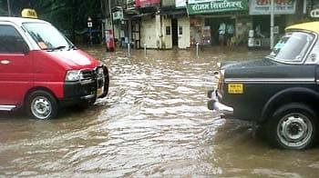 Video : Mumbai roads, trains hit by heavy rain