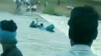 Video : Caught on camera: Two men swept away by river in Madhya Pradesh, one killed