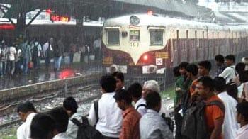 Video : Mumbai rained in: Trains, flights delayed
