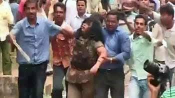 Video : Clashes outside Odisha assembly: Protestors thrash woman cop