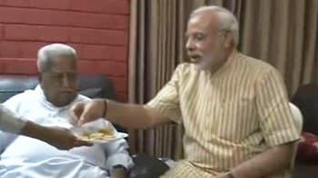 Video : Narendra Modi visits rival Keshubhai Patel, feeds him sweets