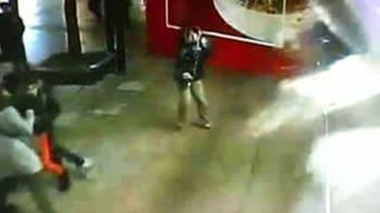 Video : Security cameras capture panic as shark tank explodes