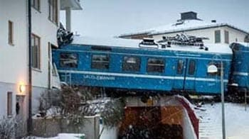 Video : Girl steals train, crashes into building in Sweden