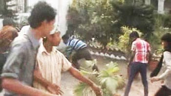 Video : Bengal: Congress minister watches as workers attack District Collector's home