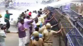 Video : Protesters clash with police outside Kerala assembly after minister quits