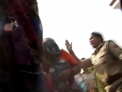 Video : Now, female cop beats up women in Uttar Pradesh