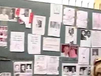 Video : Uttarakhand: At Dehradun airport, wall plastered with hundreds of photographs of those missing