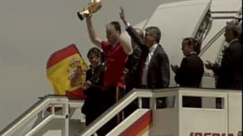 Triumphant homecoming for Spain