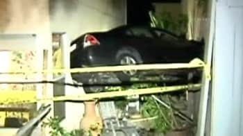 Video : Driver crashes into two homes, leaving car suspended in air