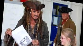 Johnny Depp visits budding pirates at a UK school