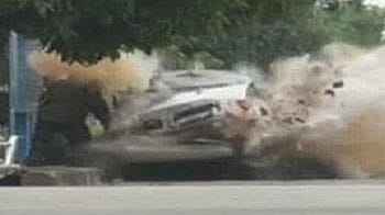 Video : Caught on camera: Car explodes as bomb squad officer tries to enter