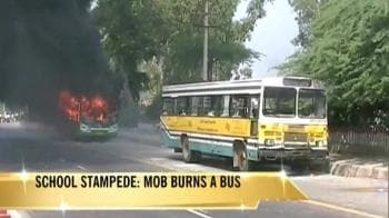 Video : Delhi school stampede: Mob sets bus on fire