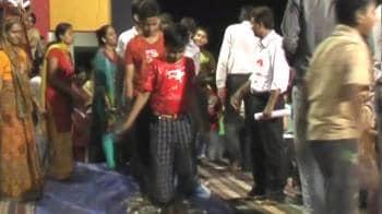 Video : Schoolkids made to walk on broken glass, fire